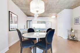 white sheer drum crystal chandelier with black dining chairs