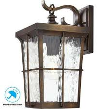 1 light golden bronze outdoor 7 5 in wall mount lantern with clear water glass