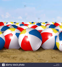 beach ball in ocean. Beach Ball Background As A Classic Symbol Of Summer Fun At The Ocean With Group Inflated Plastic Spheres Red Blue White In