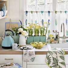 a dainty cafe curtain or half curtain is the perfect solution for a kitchen window a voile fabric in a pretty print to coordinate with your kitchen scheme