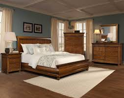 interior blue wall and brown bedroom ideas with wooden furniture