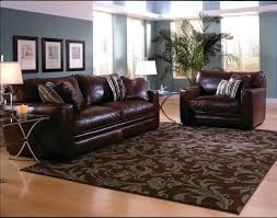 living room with dark brown leather sofa interactive pictures of rug hardwood floor for home interior accessories and decoration wonderful living room