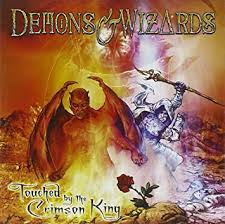 <b>DEMONS</b> & <b>WIZARDS TOUCHED</b> BY THE CRIMSON KING