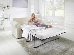 jaybe sofa bed classic pocket bed from angle with model at just british sofas the