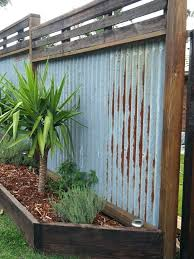 diy corrugated metal fence corrugated metal fence recycled hardwood timber fence i dreamed of this for diy corrugated metal fence