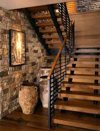 Love these contemporary stairs against the stone wall...outdoorsy in a  modern loft