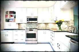 gray subway tile backsplash gray subway tile white tile white kitchen shaker cabinets gray subway tile