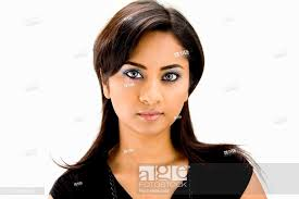 stock photo face of a beautiful hindi woman with subtle blue eye makeup and strong