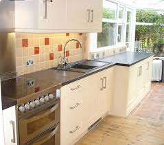 cream shaker fitted kitchen with large silgranite sink and feature tap by peter hamilton kitchens kitchens1 cream