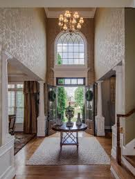 Outstanding Foyer Decorating With Floral Wall Art And Luurious High  Chandelier Ideas