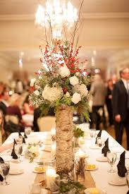 Charming winter centerpieces decoration ideas Decoratingideas Decorations Winter White Flowers And Red Wedding Centerpiece Deer Pearl Flowers 40 Stunning Winter Wedding Centerpiece Ideas Deer Pearl Flowers