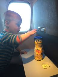 one of the best baby toys we had for airplane travel at this age was a bright starts clack and slide activity ball this baby toy was great for holding our