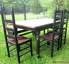 distressed black and walnut dining table bench and four ladder back from wes dalgo contemporary modern