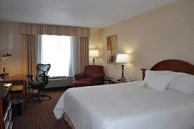 a bed or beds in a room at hilton garden inn cleveland airport