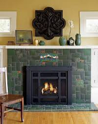 green motawi field tiles are combined with landscape and other decorative tiles in a seemingly random