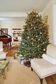 Incredible winter living room design ideas for holiday spirit Coffee Metallic Sparkler Christmas Tree Decorating 100 Fresh Christmas Decorating Ideas Southern Living