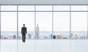 bright office. Stock Photo - Thoughtful Businessman Looking Out Window In Bright Office Interior With New York City View I