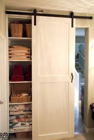 white closet sliding barn doors linen closet in laundry room