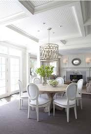 white and gray dining room with worlds away leona silver leaf pendant