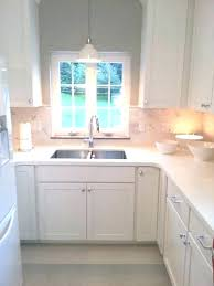 over the kitchen sink lighting wall mounted light attention pendant above what size si kitchen pendant light over sink