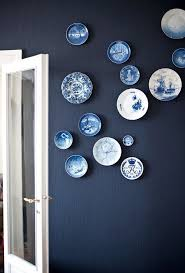 4 white and blue decorative plate hanging on