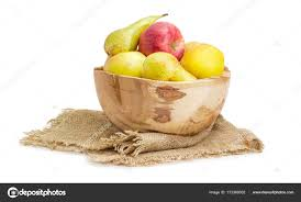 apples and pears in rustic wooden fruit bowl on sackcloth stock photo