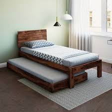 single bed. Beautiful Bed Boston Single Bed Teak Finish With Trundle By Urban Ladder