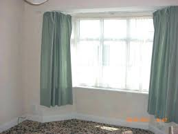 how to hang curtains in bay window how to hang curtains in a bay window large