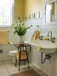 White Beadboard Wainscoting In Bathroom With Yellow Walls And One ...