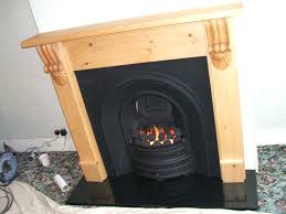 fireplaces cast iron wood fireplace with cast iron insert black granite hearth and gas fire cast fireplaces cast iron