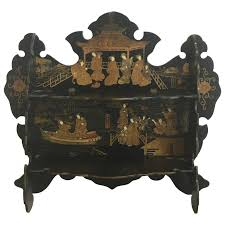 19th century asian lacquered and gilt wall shelf with an ornate paa motif for