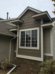 exterior siding color and mastic siding with window treatments also roof and garden landscape