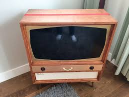 mid century tv. Simple Mid The Basic Case Is Just 34 Birch Plywood With Edge Banding Screwed Together  A Kreg Jig Affiliate Link I Sized The Top Rectangle For New TV That  In Mid Century Tv Retro Renovation
