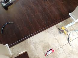 ceramic tile vs hardwood flooring cost vinyl bat difference between