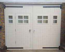 garage door with entry door via jonathanelwellinteriors co