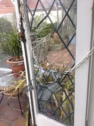 leaded glass french doors repaired after attempted break in