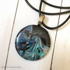 black and blue handmade polymer clay pendant by catherine blue designs