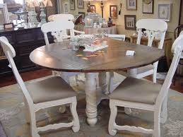 60 round drop leaf table with six matching chairs
