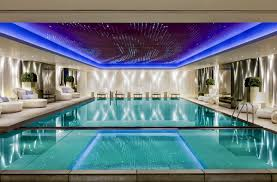 Indoor Outdoor Pool Residential Amazing Indoor Swimming Pool Design With Blue Ceiling Lighting And