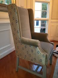 upholstery fabrics living room accents country interior oriental rug two tone wingback chair