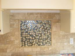 tumbled marble backsplash with glass mosaic tile