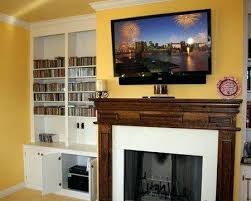 Living Room Mounting Tv Above Fireplace Cepagolf Hanging Interior Mounting A Tv Over A Fireplace