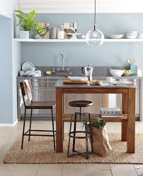 photos hgtv light filled dining room. Rustic Kitchen Island West Elm Interior Design With Glossy Granite Top On Brown Teak Wood Table Photos Hgtv Light Filled Dining Room