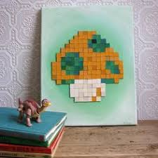 items similar to recycled book art mushroom from super mario bros find this pin and more on 8 bit