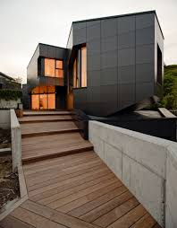 Architects asensio_mah and J.Aguirre Aldazdid did some amazing work with  the Q House in North of Spain. The jet black facade is made customized with