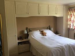 Cream fitted wardrobes L shape and over the bed with 2 bedside tables.  175.00