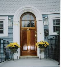 true arch top entryway door unit with double pane glass with simulated mullion window and wood panel duplication of existing door project in watertown