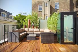 Exterior:Outstanding Roof Terrace Design With U Shape Black Wicker Sofa Set  And Black Glass