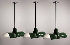 sold three matching antique green enamel porcelain light fixtures