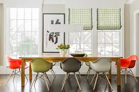 choosing multiples of the same chair in diffe colors is a great way to add visual